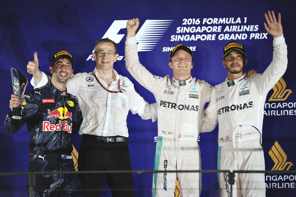 SINGAPORE - SEPTEMBER 18: Nico Rosberg of Germany and Mercedes GP, Daniel Ricciardo of Australia and Red Bull Racing and Lewis Hamilton of Great Britain and Mercedes GP on the podium during the Formula One Grand Prix of Singapore at Marina Bay Street Circuit on September 18, 2016 in Singapore.  (Photo by Mark Thompson/Getty Images)