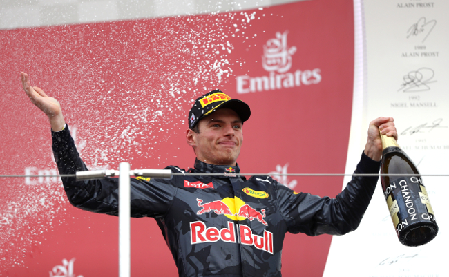 SUZUKA, JAPAN - OCTOBER 09:  Max Verstappen of Netherlands and Red Bull Racing celebrates on the podium after finishing second during the Formula One Grand Prix of Japan at Suzuka Circuit on October 9, 2016 in Suzuka.  (Photo by Clive Mason/Getty Images)