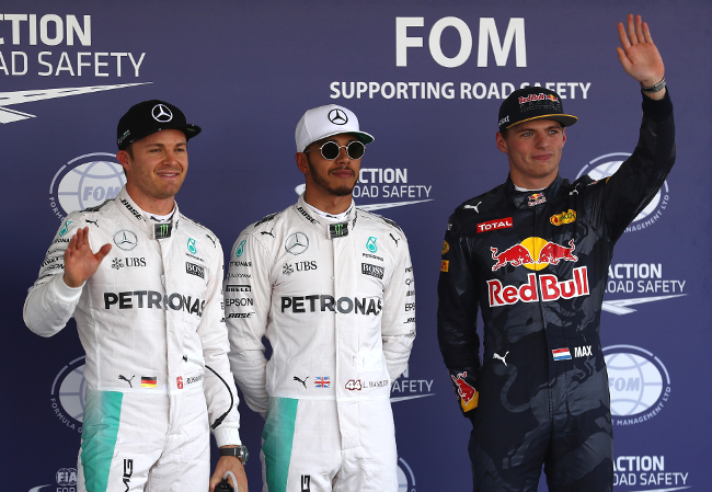 MEXICO CITY, MEXICO - OCTOBER 29:  Top three qualifiers Lewis Hamilton of Great Britain and Mercedes GP, Nico Rosberg of Germany and Mercedes GP and Max Verstappen of Netherlands and Red Bull Racing in parc ferme during qualifying for the Formula One Grand Prix of Mexico at Autodromo Hermanos Rodriguez on October 29, 2016 in Mexico City, Mexico.  (Photo by Clive Mason/Getty Images)