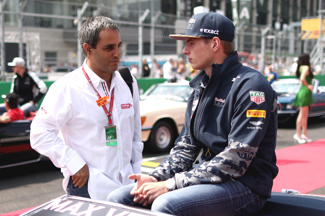 MEXICO CITY, MEXICO - OCTOBER 30:  Max Verstappen of Netherlands and Red Bull Racing talks with ex racer Juan Pablo Montoya on the drivers parade before the Formula One Grand Prix of Mexico at Autodromo Hermanos Rodriguez on October 30, 2016 in Mexico City, Mexico.  (Photo by Lars Baron/Getty Images)